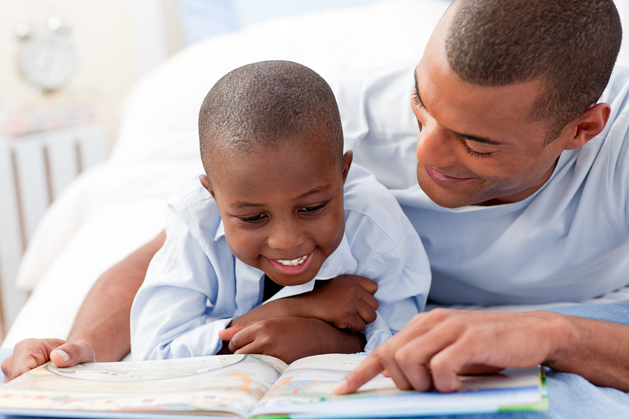 A Father And His Boy Reading